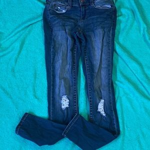 Mudd ripped dark blue jeans.